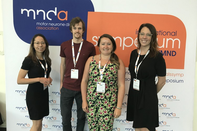 Four researchers at the MND Association International Symposium