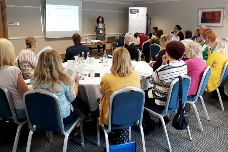 Sharon Abrahams delivering a masterclass to a room full of health professionals.
