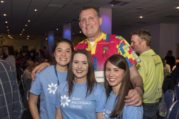 Doddie Weir with three MND Researchers in blue T-shirts