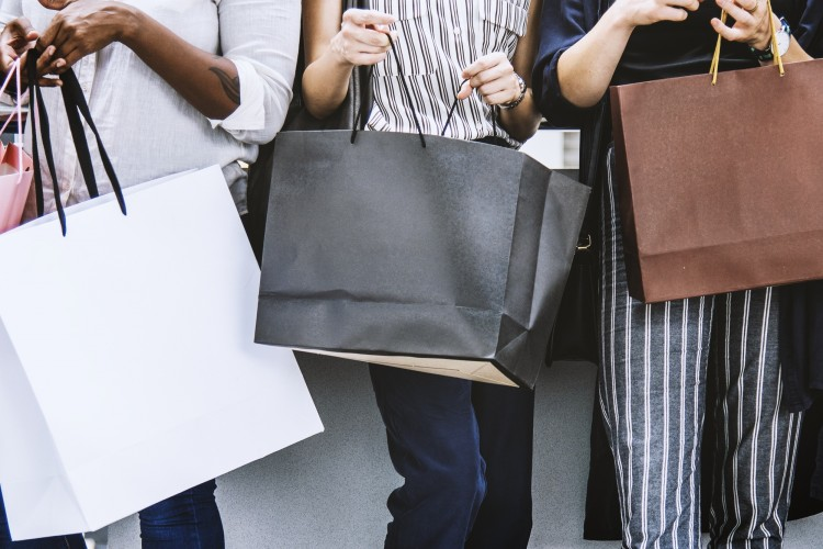people holding shopping bags