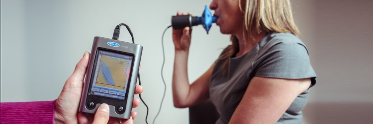 A woman taking a breathing test